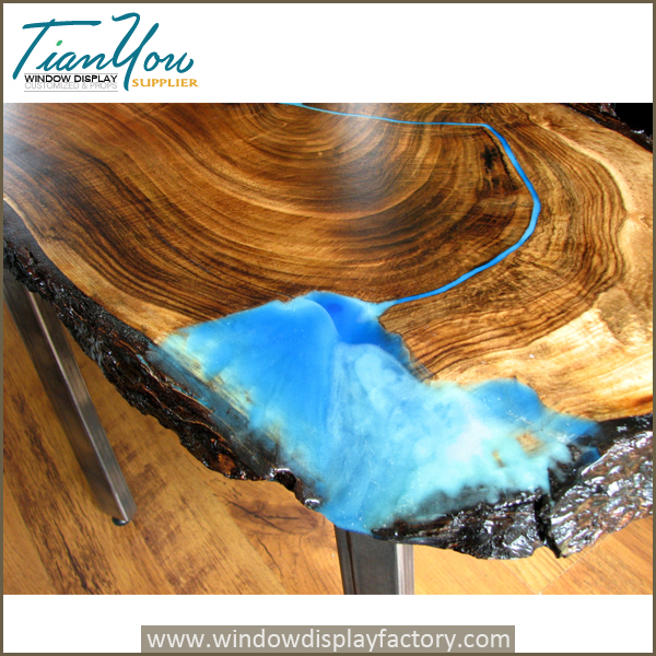 Live edge waterfall coffee table with glowing resin in the dark