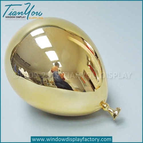 Electroplated gold balloon props